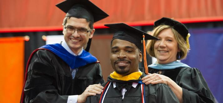 Faculty and staff celebrate the graduating class at commencement.